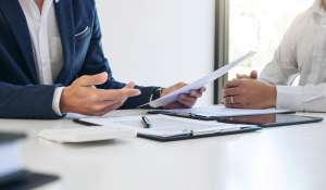 Insurance agent explaning document contents to a client.